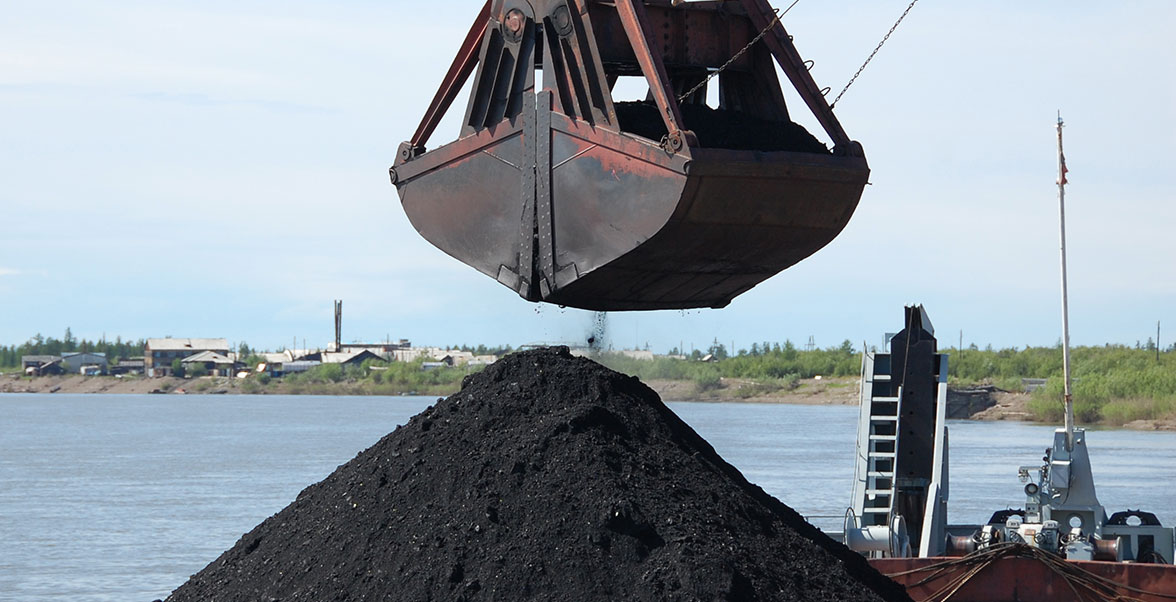 bulk coal pile with crane claw