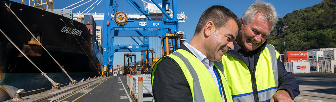 Two men in discussion at Port Otago terminal