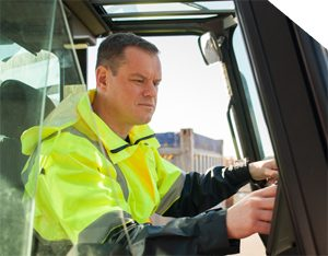 man in vehicle at a port using vehicle app